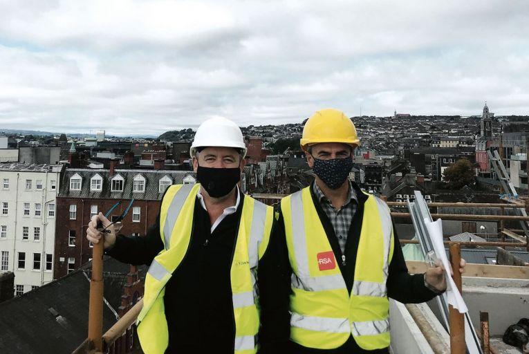 Eoin Doyle and Ray Byrne on the roof of their new 'micro-sleeper' ReZz hotel on MacCurtain Street in Cork