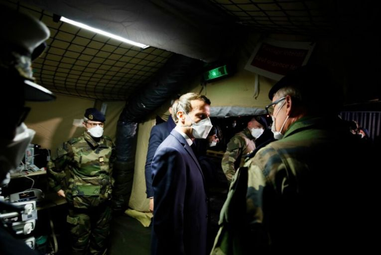 Emmanuel Macron visits a field hospital in Mulhouse. The French president is part of a generation of leaders who are much more interventionist, and not just in economic terms. Picture: Pool/AFP via Getty Images