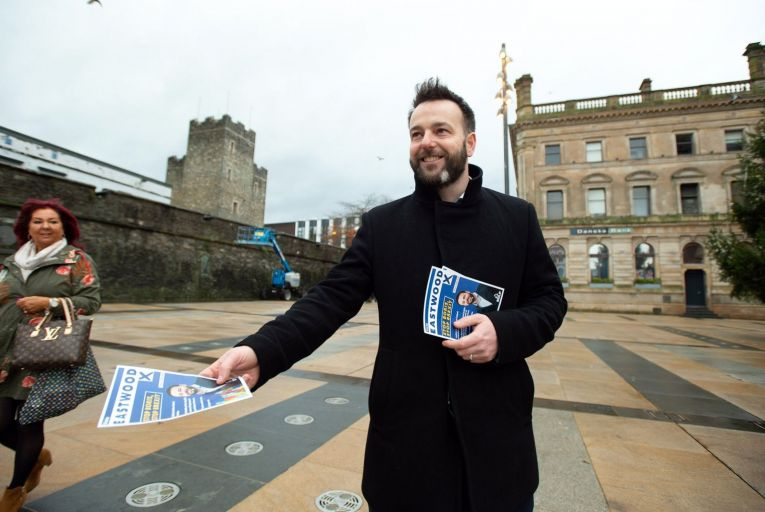 SDLP leader Colum Eastwood canvassing outside the Guildhall in Derry city. (Pic: Joe Dunne)