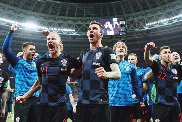 Domagoj Vida (21), Mario Mandzukic  (centre) and their Croatia teammates  celebrate after their extra-time win  over England in Moscow last WednesdayPic:  Picture:  Yohei Osada/AFLO SPORT