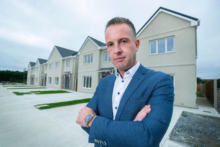 Enda Byrne, managing director of Carlow Concrete, outside some of their finished housing units. Picture: Finbarr O'Rourke