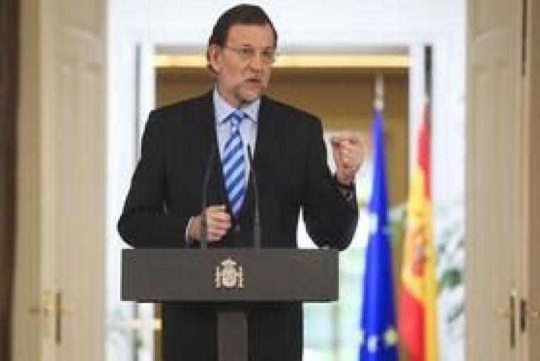 Spain's Rajoy pledges battle for euro