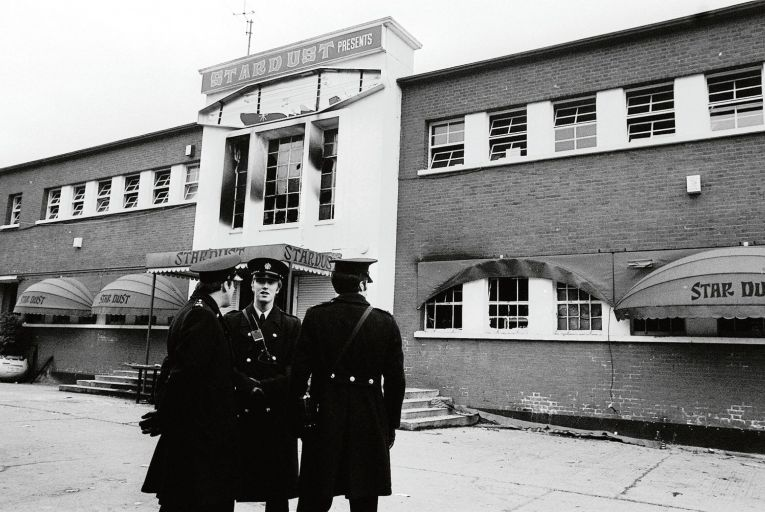 Gardaí stand outside the main entrance of the Stardust nightclub in Artane, Dublin, where 48 young people died in a fire in 1981. Picture: PA