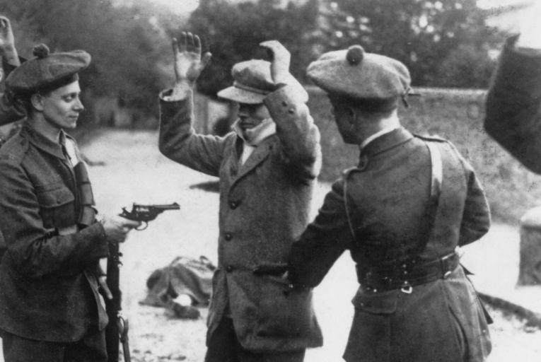 A suspected member of Sinn Féin is searched at gunpoint by members of the Black and Tans, during the Irish War of Independence in 1920. Picture: Getty