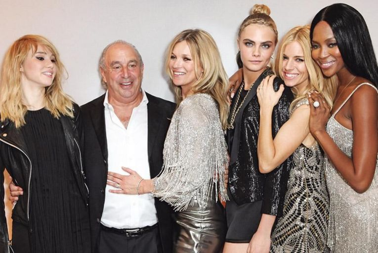 Philip Green, the owner of Topshop, with models Suki Waterhouse, Kate Moss, Cara Delavigne, Sienna Miller and Naomi Campbell  Pic: Getty