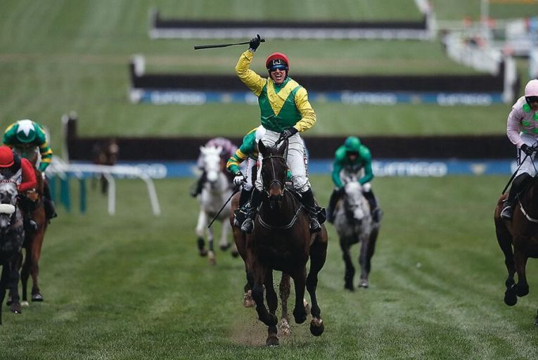Robbie Power wins  the Cheltenham Gold Cup  riding Sizing John last Friday Picture: Getty