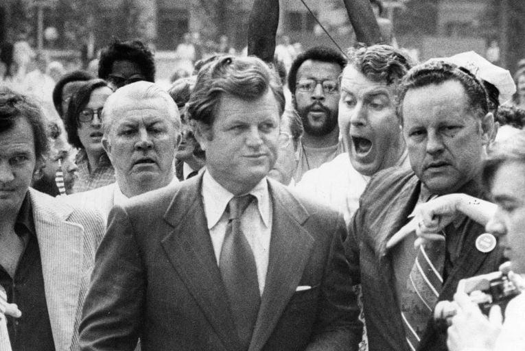 Ted Kennedy walks through an anti-busing crowd in Boston in 1975. Picture: Joe Dennehy/The Boston Globe/Getty