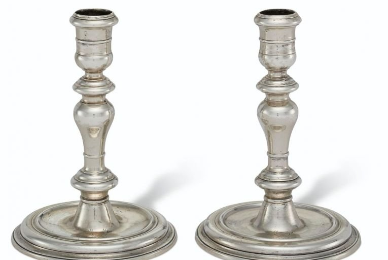 A pair of Queen Anne candlesticks are expected to fetch $4,000-$6,000