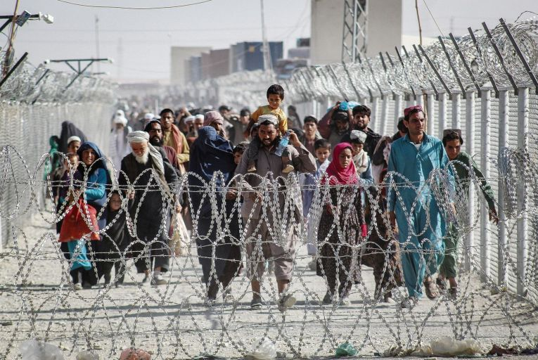 Afghans arrive in Pakistan through the border crossing point in Chaman last week. It is estimated that up to five million Afghans could attempt to flee the Taliban following the US withdrawal. Picture: AFP/Getty Images