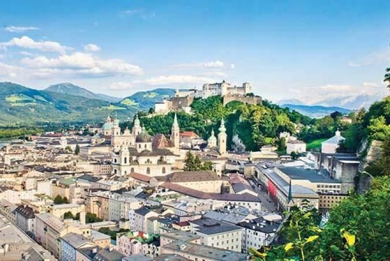 The picturesque city of Salzburg, with the Alps in the background