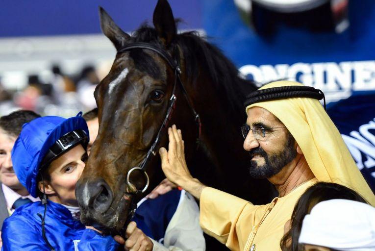 Sheikh Mohammed bin Rashid al-Maktoum, ruler of Dubai, celebrates with jockey William Buick in 2017 after winning the Dubai World Cup