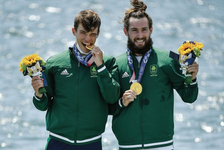 Fintan McCarthy, left, and Paul O'Donovan of Ireland celebrate with their gold medals after winning the Men's Lightweight Double Sculls final in Tokyo. Picture: Getty