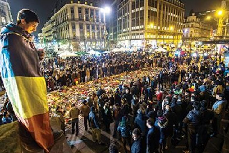 Hundreds gather at a makeshift memorial to the bombing victims on Place de la Bourse in Brussels  All pictures: Getty