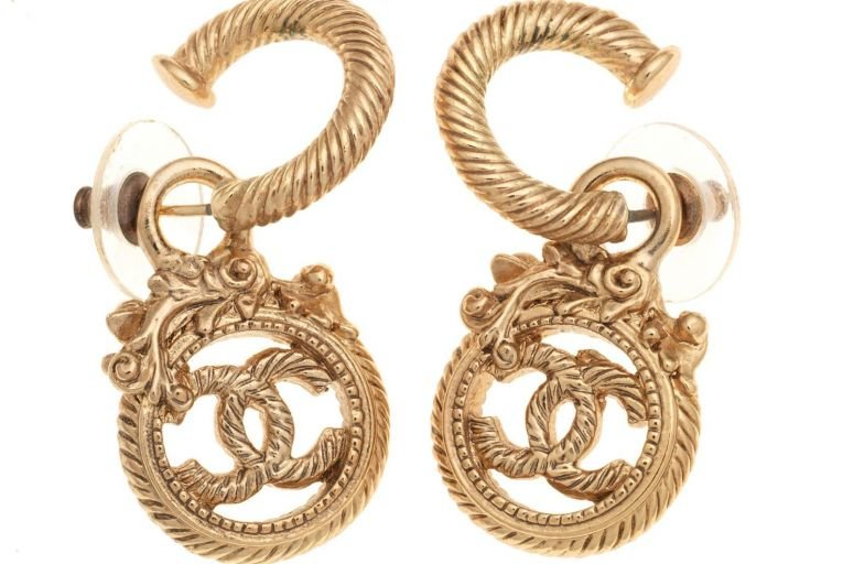 A pair of gilt twist CC drop earrings have an estimate of £200-£300