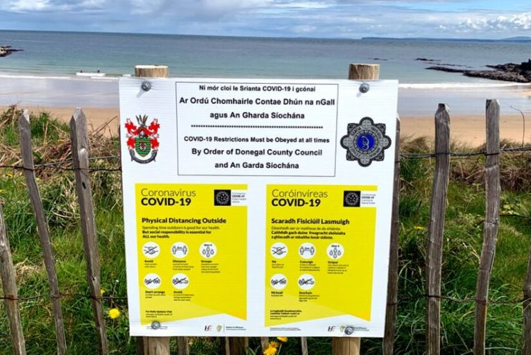 A notice reminding visitors to a Donegal beach of Covid-19 restrictions