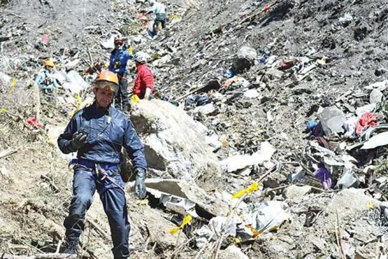 Search and rescue workers collect debris at the crash site of the Germanwings  Airbus A320 in the French Alps,   above the town of Seyne-les-Alpes  Picture: EPA