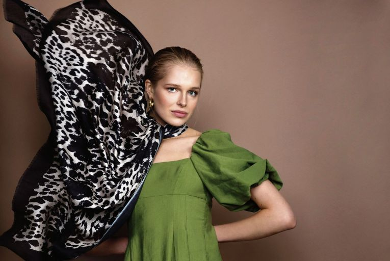 'Leopard' modal scarf, €110, at brownthomas.com and kdk.ie;  earrings, €50, Baublebar, Brown Thomas, and dress, €59.95, Zara