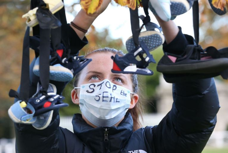 Rebecca Coughlan, from Blanchardstown, Dublin, ties baby shoes to a gate during a Mother and Baby Home protest at Áras an Uachtaráin last October. Photo: Sasko Lazarov/ RollingNews.ie