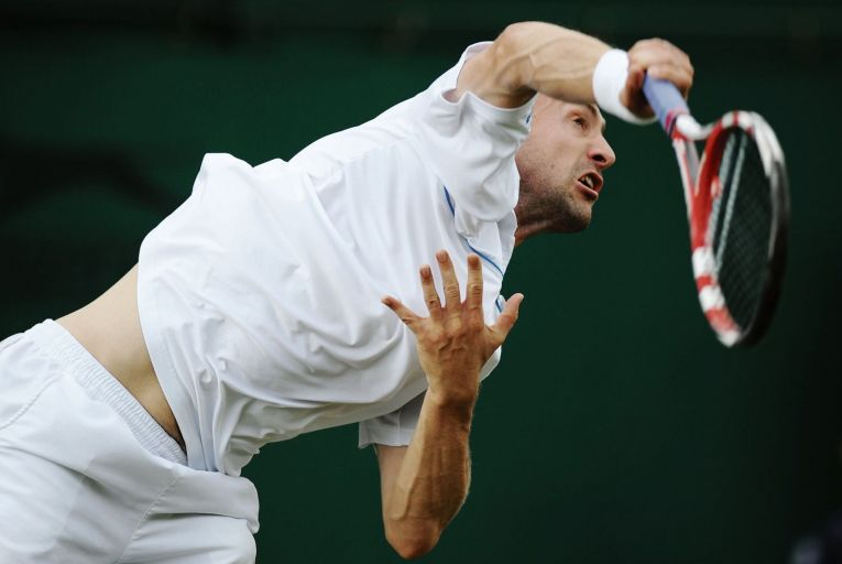 Conor Niland serves during his first-round match against Adrian Mannarino of France on Day Two of Wimbledon 2011. Picture: Getty