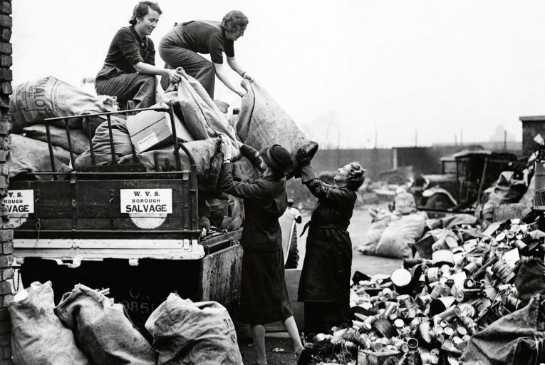 Volunteers from the Women\'s Voluntary Service in Britain unload bags of salvaged goods at a sorting depot. The history of salvaging and reusing is the subject of a new book by Emily Cockayne. Photo: Getty