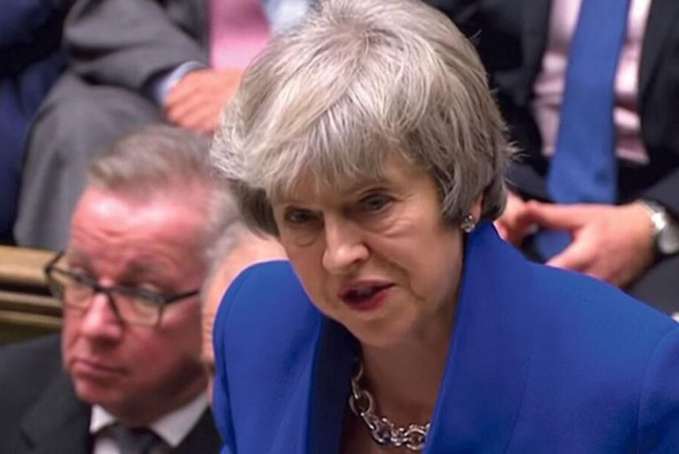 Theresa May tries to maintain her composure on the day of her historic defeat on Brexit