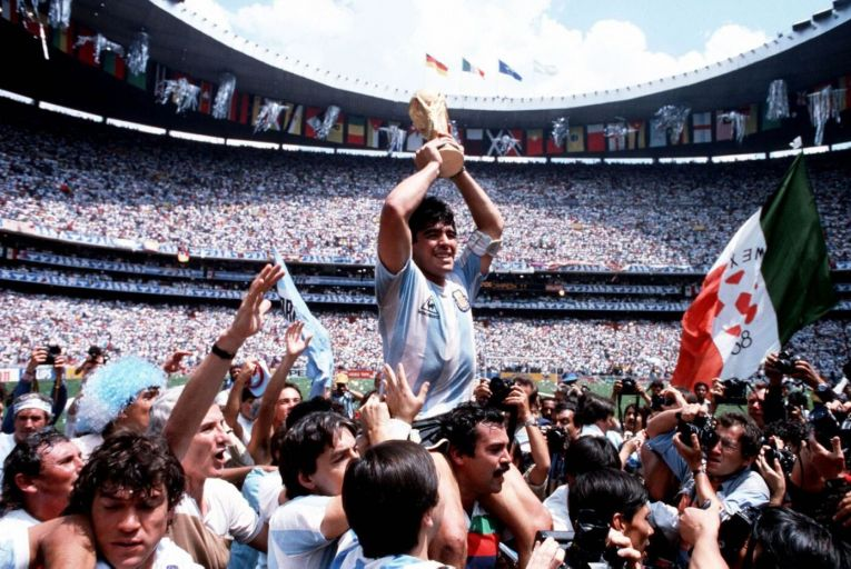 Diego Maradona holds the World Cup trophy while being carried on his teammates' shoulders on June 19, 1986 Picture: Getty