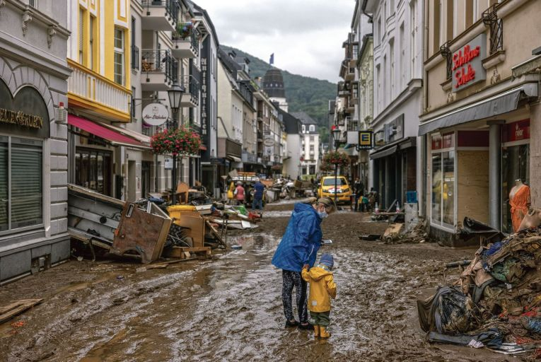 People walk through the flood damaged city center of Bad Neuenahr, Germanym, devastated by a flash flood . PIcture: Getty