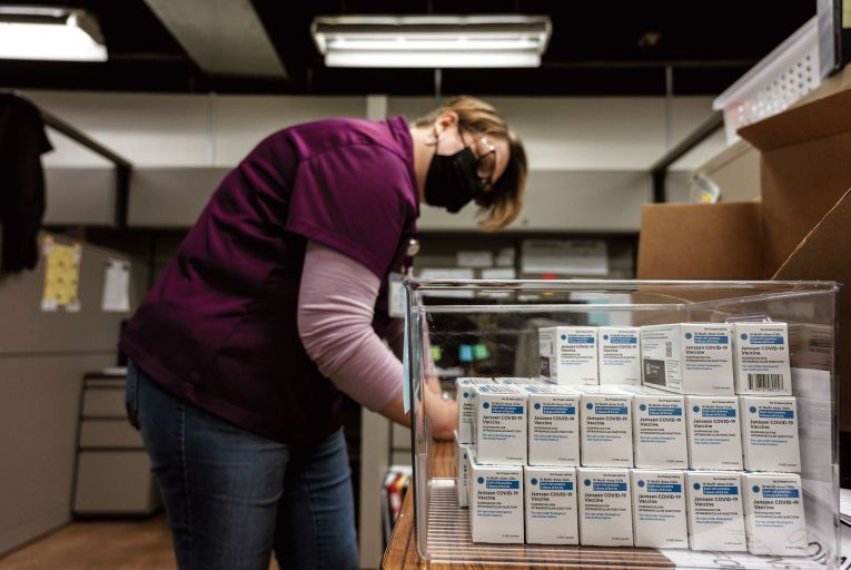 A health worker with boxes of the Johnson & Johnson 'single shot' vaccine at the Louisville Metro Health and Wellness HQ in Louisville, Kentucky in the US  Getty