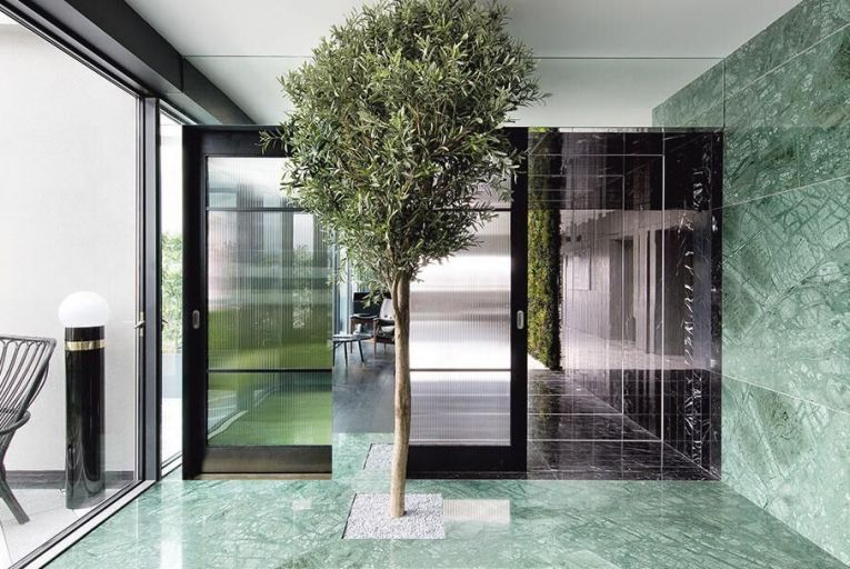 Marble LED tunnel and brass bar, private office by KLD Pictures: Barbara Corsico