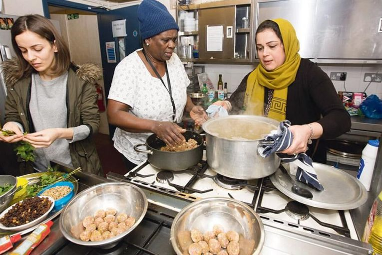Home comforts: women at work at Migrateful in London, including Elahe Reza (right), originally from Iran