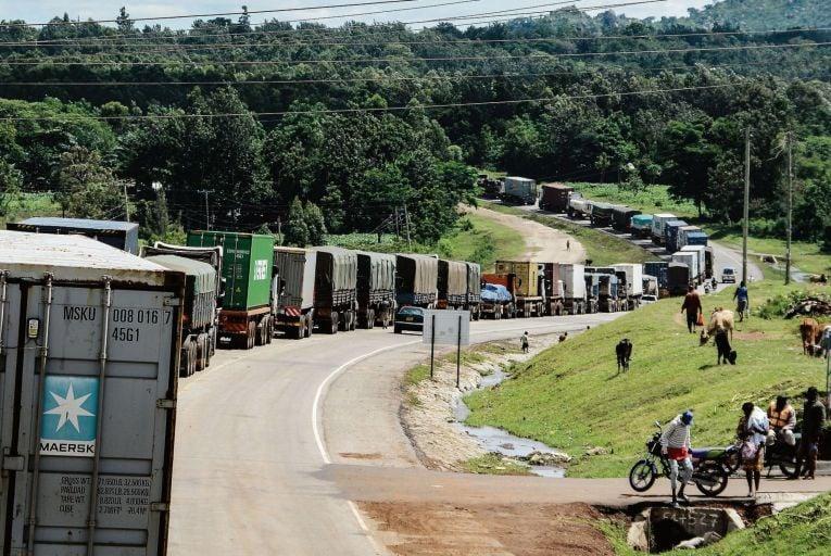 Trucks wait in a line on the road to enter Uganda in Malaba, a city bordering with Uganda, western Kenya
