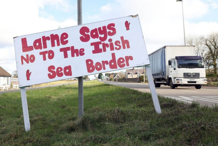 A sign on the approach to the port town of Larne in Co Antrim protesting against the so-called Irish Sea border imposed by the Northern Ireland protocol as part of Brexit. Photo: Stephen Davison