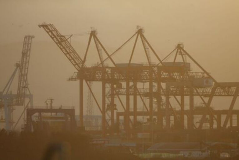Factories, cranes, chimneys and other signs of industry in Dublin Bay shrouded in haze. The Environmental Protection Agency has said it is not optimistic about Ireland's performance on climate change unless policy efforts are accelerated. Photograph: Sam Boal/RollingNews.ie