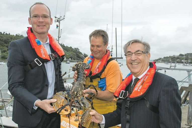 Karmenu Vella, European Commissioner for Environment, Maritime Affairs and Fisheries seen here in Crosshaven, Co Cork, with then-Minister for Agriculture, Food and the Marine, Simon Coveney and Kevin Healy, lobster fisherman