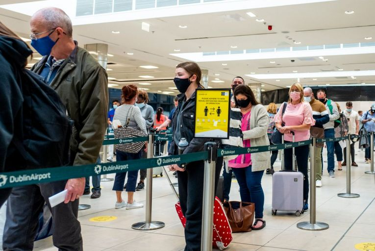 Passengers wearing facemasks at Dublin Airport last August: international travel is scheduled to resume next month. Picture: Getty