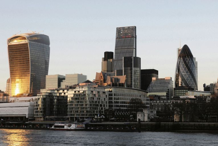 London's skyline with the famous Walkie Talkie building, the Gherkin and the Cheesegrater at sundown along the river Thames