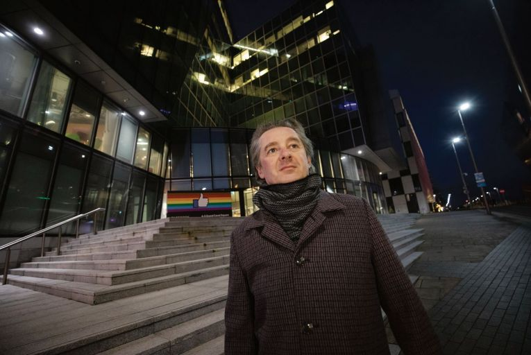 Chris Gray, a former community operations analyst for Facebook, pictured outside its headquarters in central Dublin. Picture: Fergal Phillips