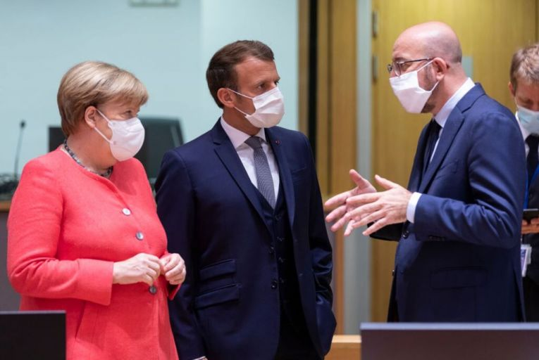 Angela Merkel, the German chancellor, Emmanuel Macron, the French president, and Charles Michel, president of European Council, talk during the summit in Brussels which was one of the longest in the EU's history. Picture: Getty