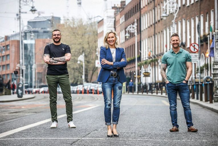 James Nelson, left, and Adam Oberem, right, co-founders of Lucky Beard, with Elaine Devereux, its Irish managing director. Picture: Conor McCabe