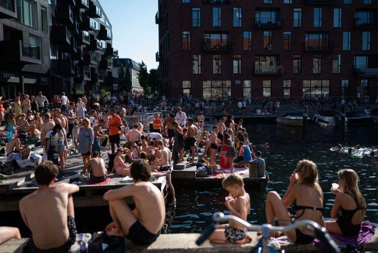 People enjoying the weather on the waterfront in Copenhagen. Picture: Getty