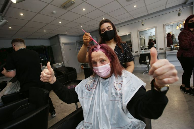 Hairdresser Rebecca Walsh with customer Mary Leonard at the newly-reopened Ross Adams Hair and Beauty Saloon in the Square, Tallaght, last week. Picture: Stephen Collins