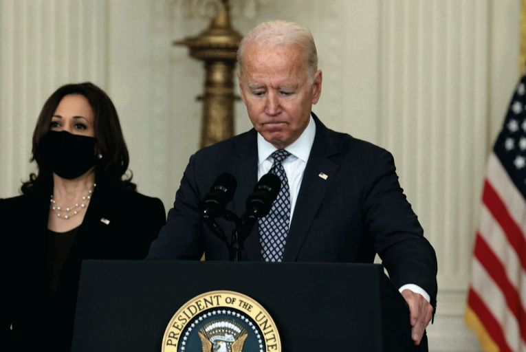 Joe Biden addresses the media on the US withdrawal from Afghanistan as his vice-president Kamala Harris looks on. Picture: Getty