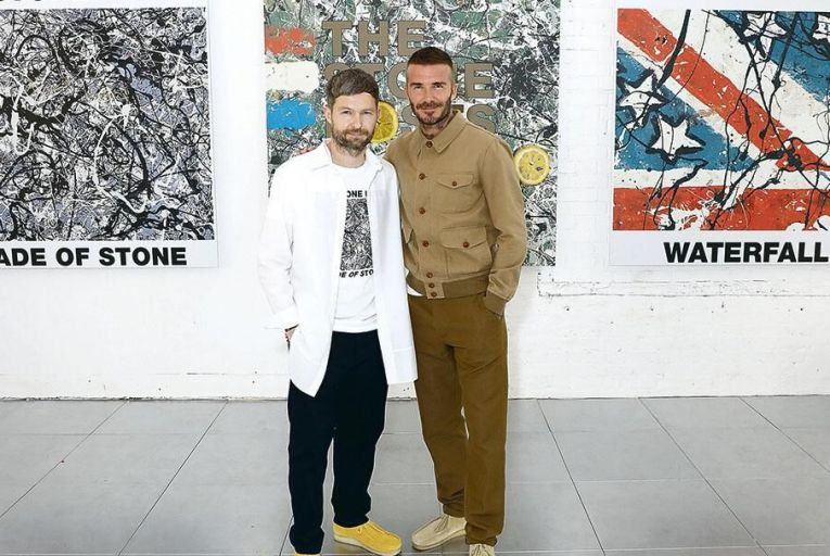 Daniel Kearns and David Beckham attend the Kent & Curwen show during London Men's Fashion Week WireImage