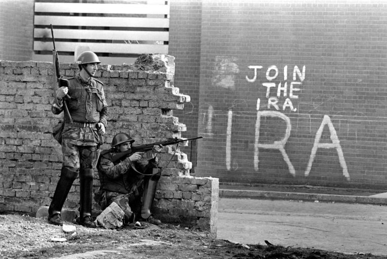 Soldiers in Northern Ireland in 1971 as graffiti encourages local Catholics to join the IRA, September 1971. Picture: Mirrorpix/Getty