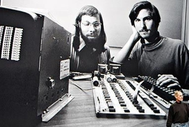 Steve Jobs delivers a speech in front of a file photograph of himself and Wozniak at the launch of the Apple iPad in San Francisco in January 2010 Pic: Bloomberg