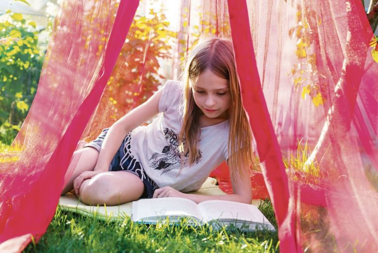 This is the perfect time to nurture a child's appreciation of the pleasures of reading. Picture: Getty Images/Westend61