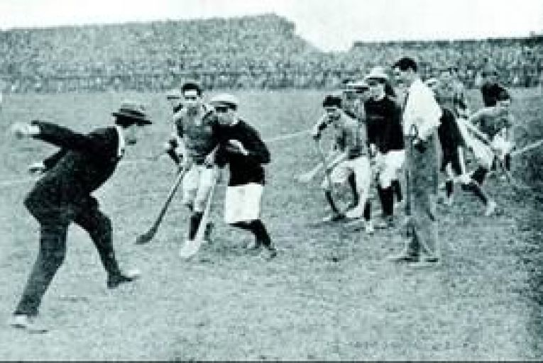 Michael Collins, Sinn Féin leader and Commander-In-Chief of the Irish Free State Army, throwing in the sliotar to start a hurling match at Croke Park, Dublin in 1921. Photo: Getty
