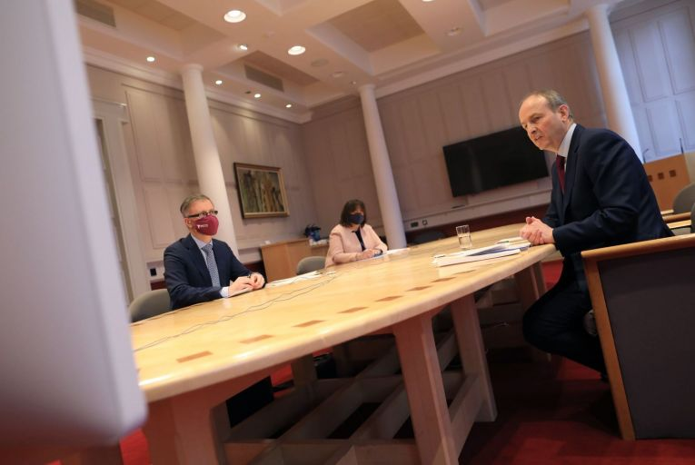 Taoiseach Micheál Martin, right, and Roderic O\'Gorman, the Minister for Children, speak to survivors earlier today via video link. Picture: Julien Behal