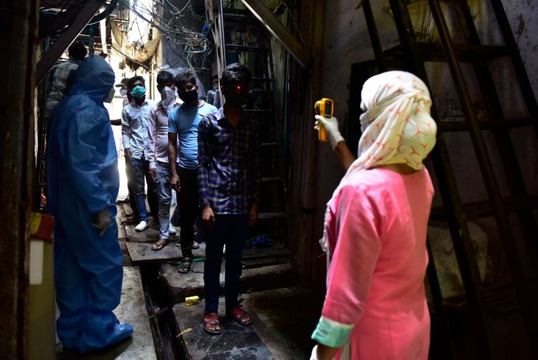 Doctors conduct door to door screening in Mumbai. The quarantine experience in countries like India is vastly different to wealthier parts of the world. Picture: Getty