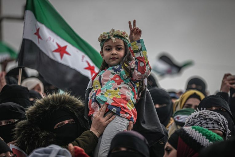A Syrian girl gestures during a demonstration against Bashar al-Assad's regime as the Syrian civil war entered its 11th year in Idlib, Syria on March 18. Picture: Getty